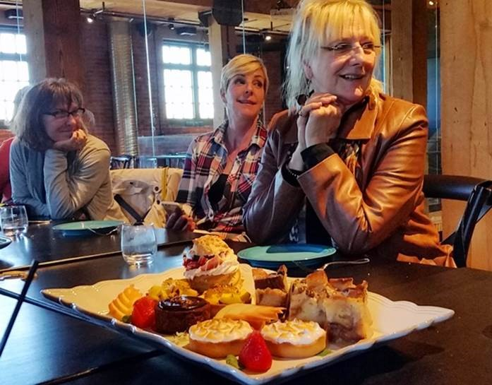 TMAC AB & NWT members Deb Cummings, Lisa Monforton and Carol Patterson show restraint  before devouring decadent desserts from Sidewalk Citizen Bakery (Photo Credit: Debra Smith)